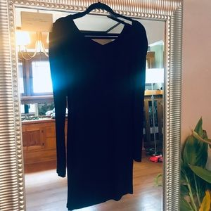 Long sleeve black mini dress.